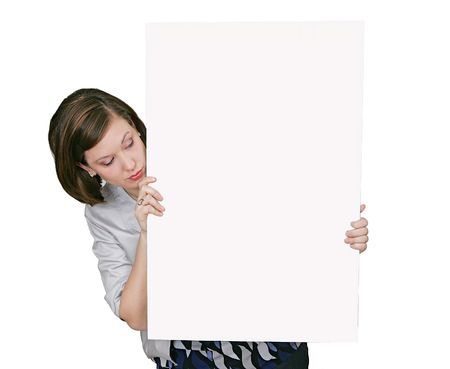 a young caucasian woman looking at a blank sign
