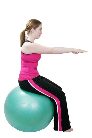young girl stretching doing pilates exercises on a swiss ball Stock Photo - 2809542