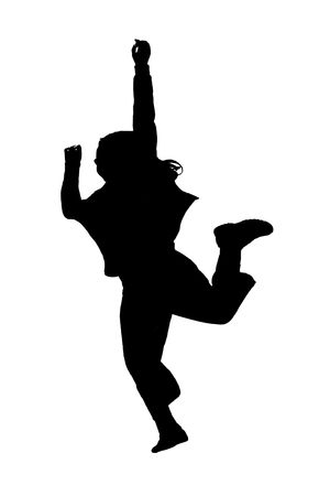 young female child playing and jumping in silhouette photo