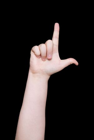 nonverbal communication: the letter l in sign language on a black background