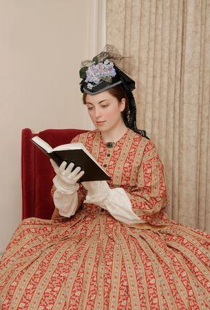 reenactor playing young civil war era woman reading a book photo