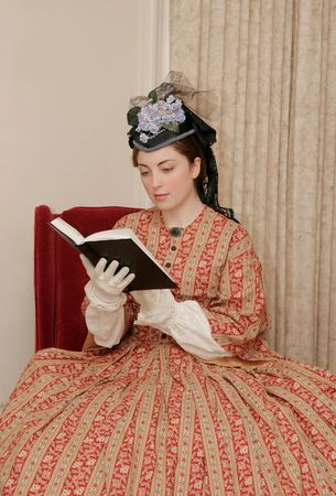 reenactor playing young civil war era woman reading a book