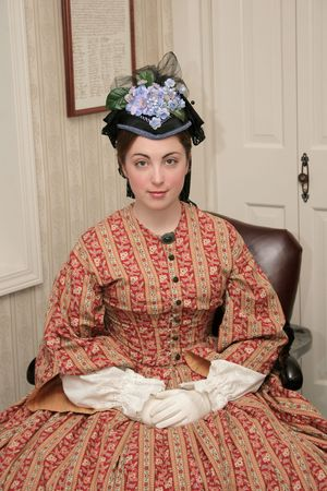 era: portrait of a Civil War 1860s era woman sitting in a chair