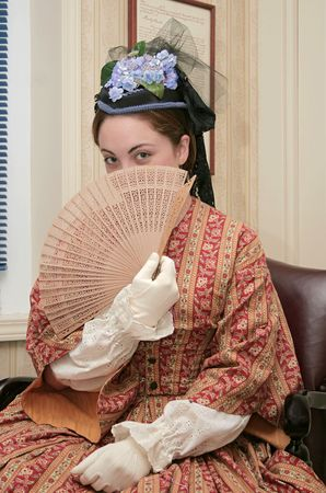 young woman with a fan dressed in 1860s style clothing