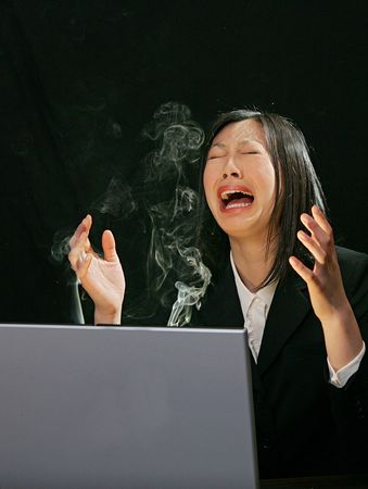 young attractive asian woman working on a laptop computer