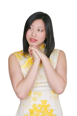 coy: attractive asian woman on a white background being coy or shy Stock Photo