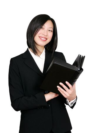 an asian businesswoman smiling and holding a book photo