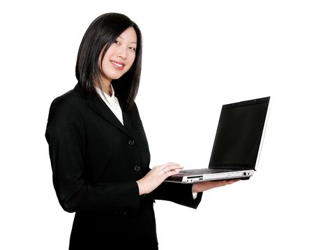 pretty asian businesswoman holding a laptop computer and working photo