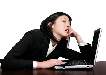 Passed out: young businesswoman asleep at her computer  Stock Photo