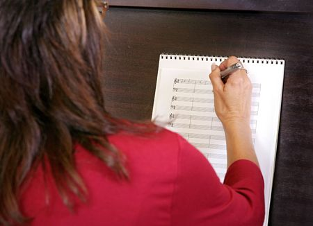 close view of a woman composing new music