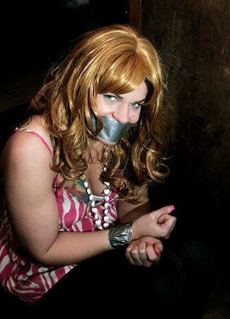a woman tied and taped up kidnapped in a dark environment Stock Photo - 2977513
