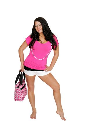 purchasing: young fashion woman in hot pink and black outfit with shopping purse over white