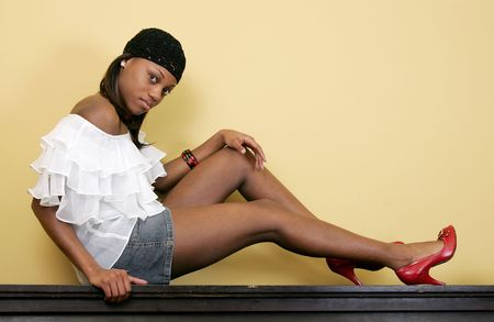 a gorgeous, attractive African American woman sitting on top of a piano