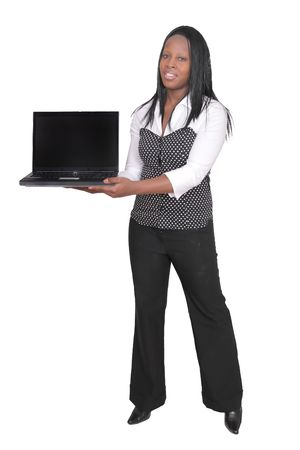 African American woman holding a black laptop over white Фото со стока