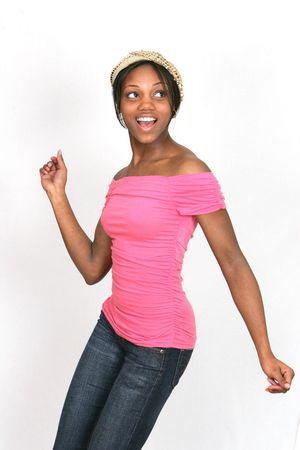 African American girl in a pink shirt posing over a white background looking happy and energetic Stock Photo