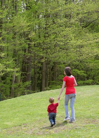 mom and child going for a walk to go fishing with poles in hand