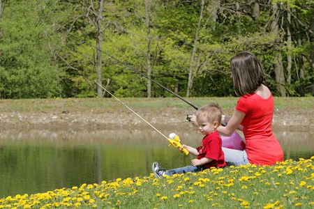 a woman and her young boy child go fishing at the pond Banque d'images