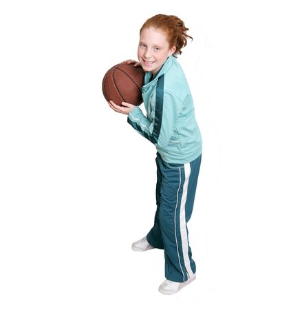 a red headed girl with a brown leather basketball over white Stock Photo