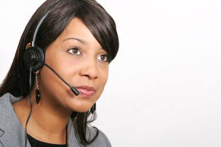 an adult female customer service representative headshot portrait with her headset on ready to work photo