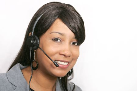 an adult female customer service representative headshot portrait with her headset on ready to work Banque d'images