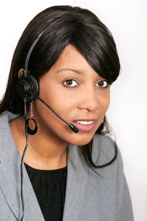 an adult female customer service representative with her headset on ready to work photo