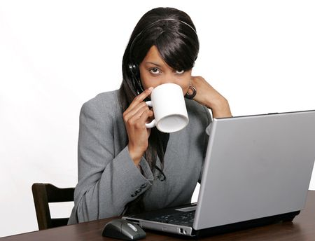 an adult female customer service representative with a cup of coffee taking a break photo