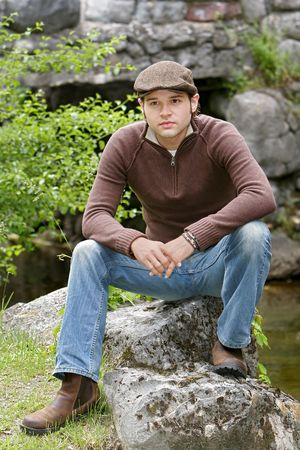 portrait of a young male with brown hair in the park Stock Photo - 3137991