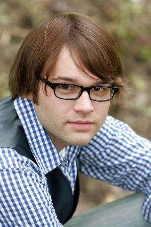 portrait of a young male with brown hair in the park Stock Photo - 3137831