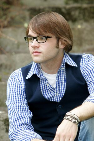 portrait of a young male with brown hair in the park Stock Photo - 3137801