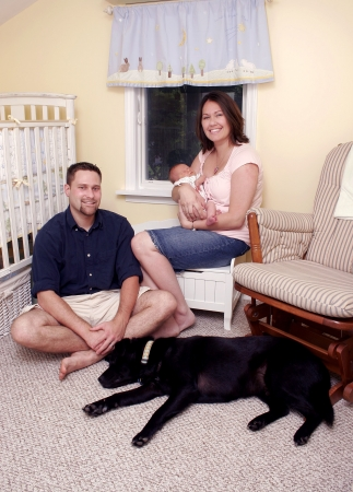 a small family with their dog Stock Photo - 3249205