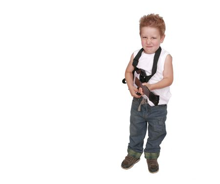one young boy having fun playing a fake toy guitar over white with copyspace