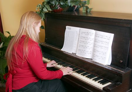 one woman in red shirt playing piano