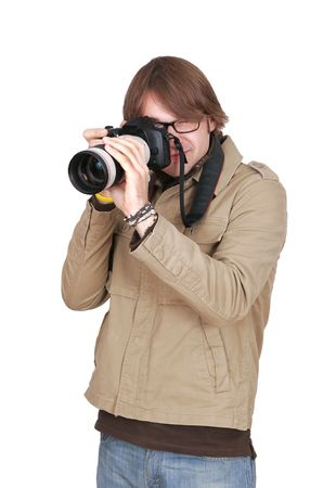 a young male photojournalist with a large camera over white Stock Photo