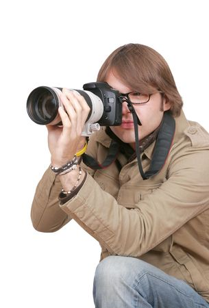 a young male photojournalist with a large camera over white photo