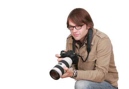 a young male photojournalist with a large camera over white Stock Photo - 3283144