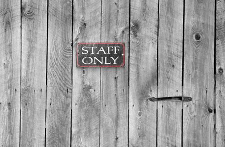 staff only: staff only sign on an old wooden door