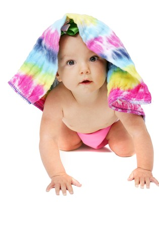 one young baby girl posing under a colorful cloth diaper over white Stock Photo