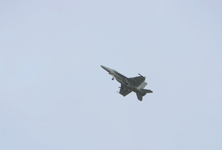 a fighter jet flying high in the sky Stock Photo