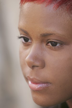 pretty African American woman face closeup headshot portrait outdoors with sharp eye detail photo