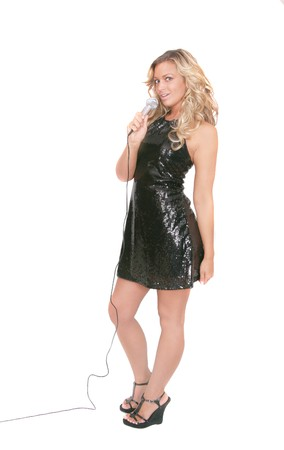 one attractive sexy adult female rockstar in a black dress over white full length photo