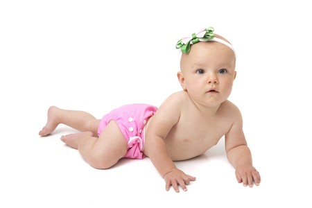 diaper: one full length portrait of a young baby girl in her cloth diaper over white