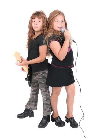 two young female childred playing guitar and singing like rockstars over white