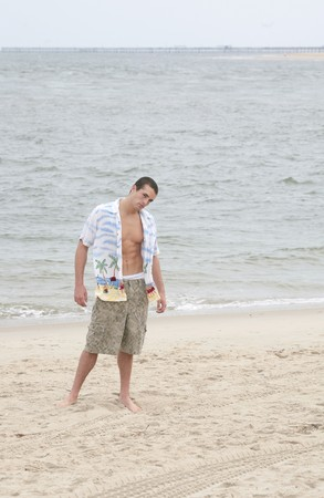 one young man standing on the beach full length portrait Stock Photo - 3974681