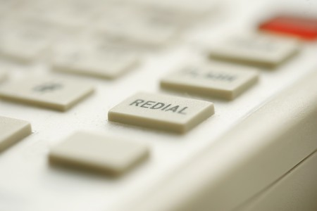 intentional: super macro closeup of a redial button isolated from the rest intentional shallow depth of focus