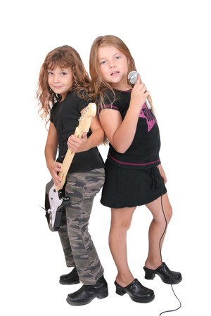 rockstars: two young female childred playing guitar and singing like rockstars over white