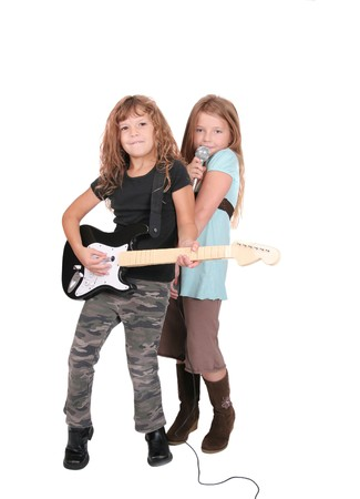 two young female childred playing guitar and singing like rockstars over white photo
