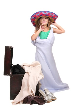 dressup: young child putting on adult clothes playing dressup over white