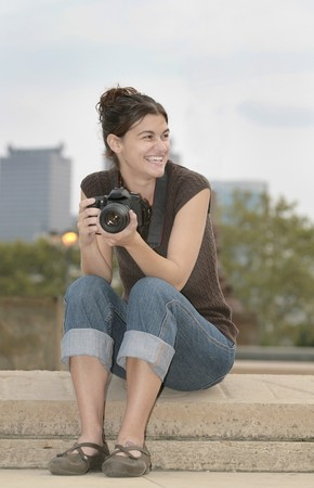 one brunette woman taking photos with professional camera in the city Stock Photo - 4162610