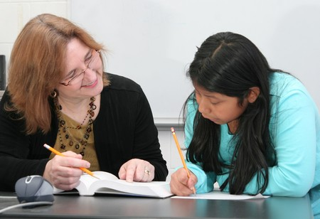 one young female student getting help from a teacher Stock Photo - 4337089