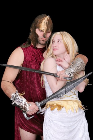 one greek soldier holding a blonde goddess woman hostage over black photo
